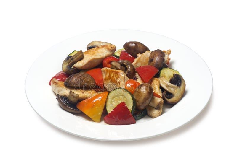 O abobrinha sauteed com galinha cresce rapidamente pimenta de sino foto de stock