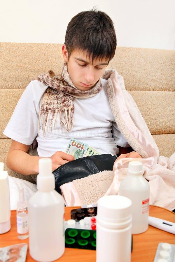 O adolescente doente verifica a carteira imagens de stock