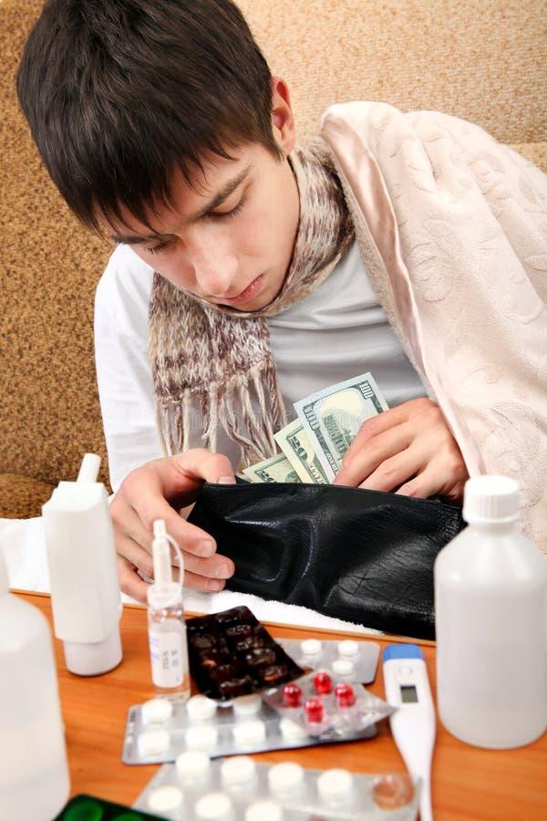 O adolescente doente verifica a carteira fotografia de stock royalty free