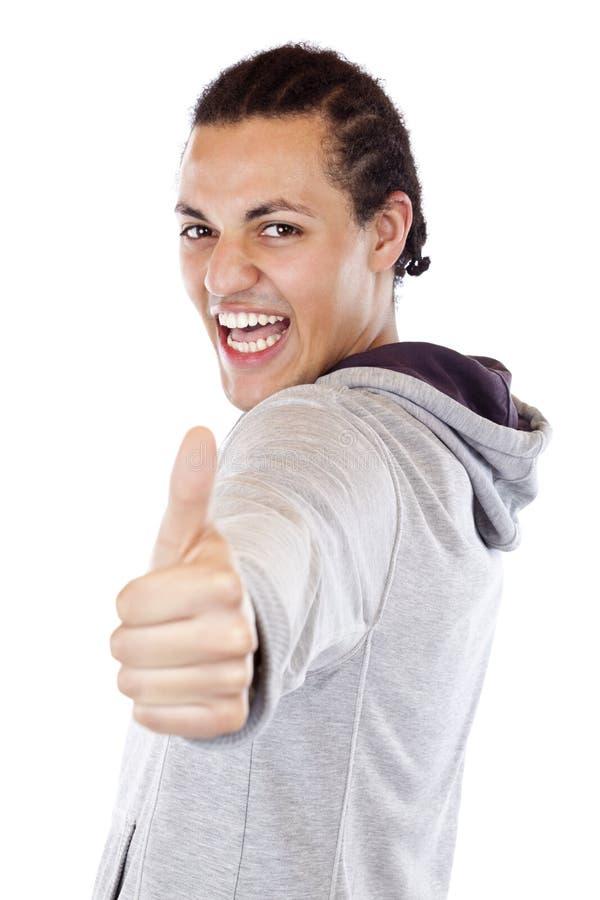 O adolescente entusiástico mantem o polegar foto de stock royalty free