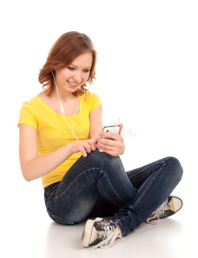 O adolescente escuta música imagem de stock royalty free