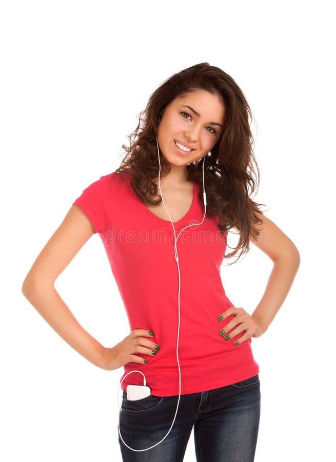 O adolescente escuta música fotos de stock royalty free