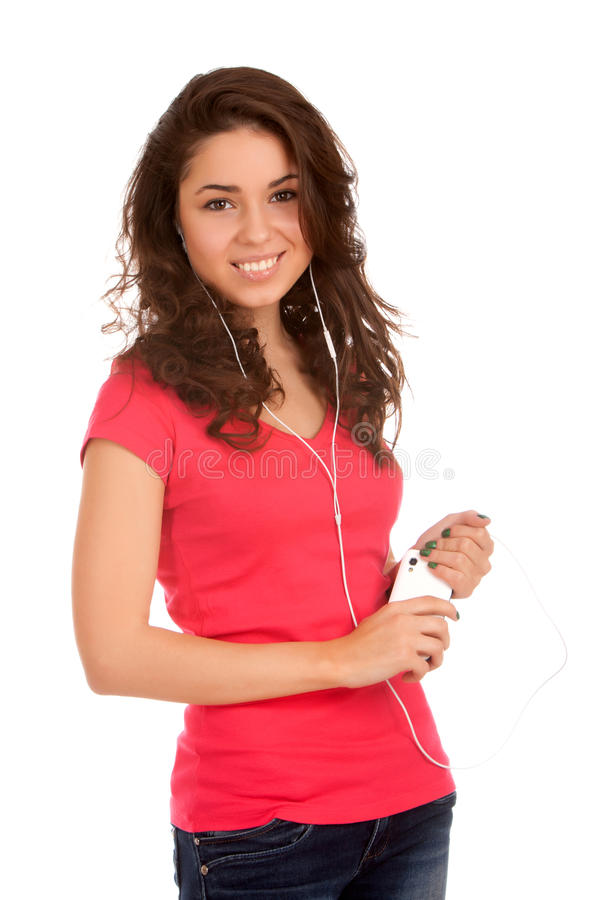 O adolescente escuta música fotos de stock