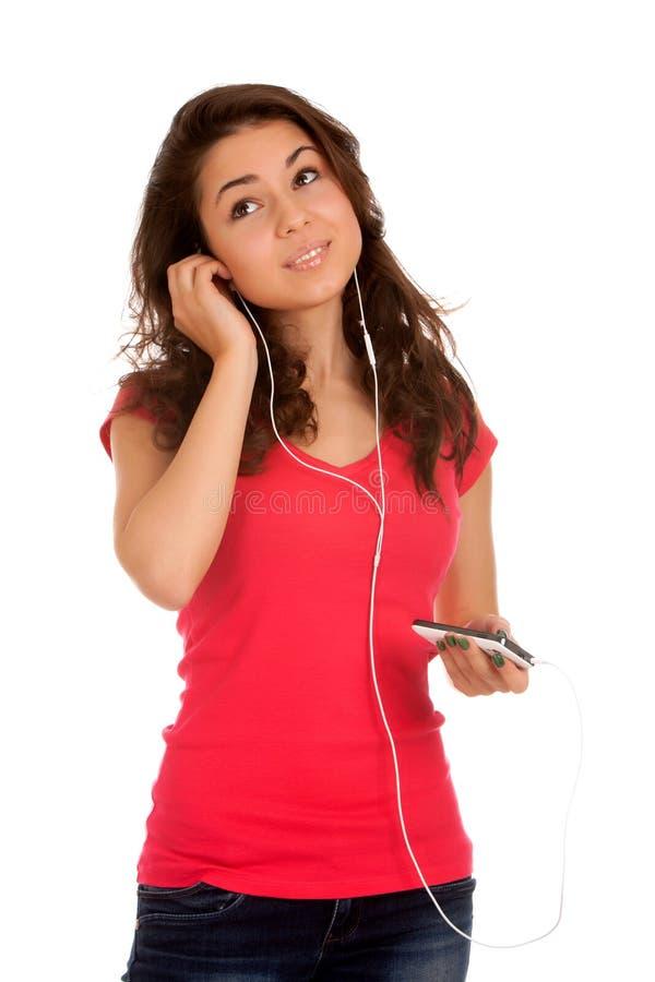 O adolescente escuta música foto de stock royalty free