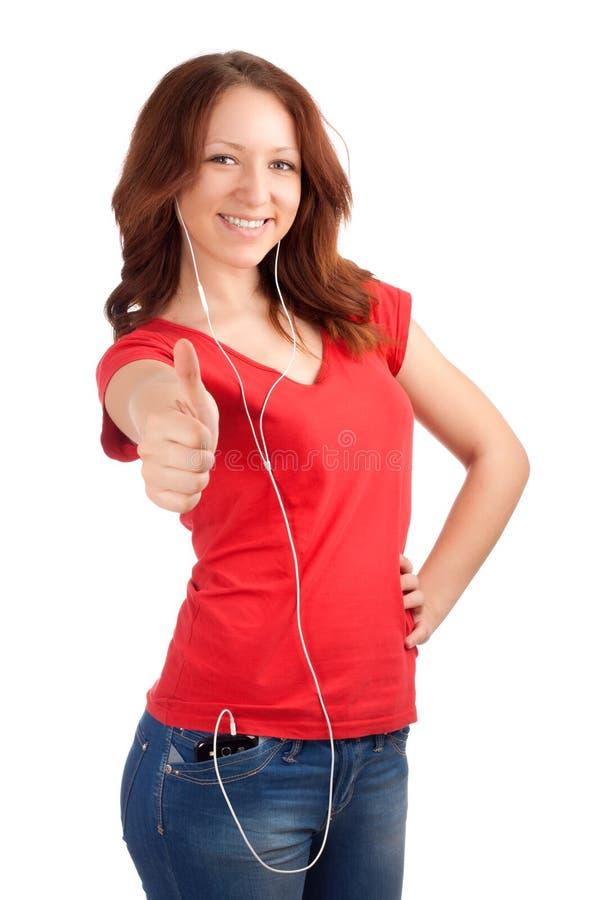 O adolescente escuta música imagem de stock