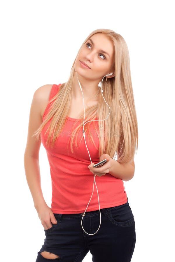 O adolescente louro escuta música e sonho fotografia de stock