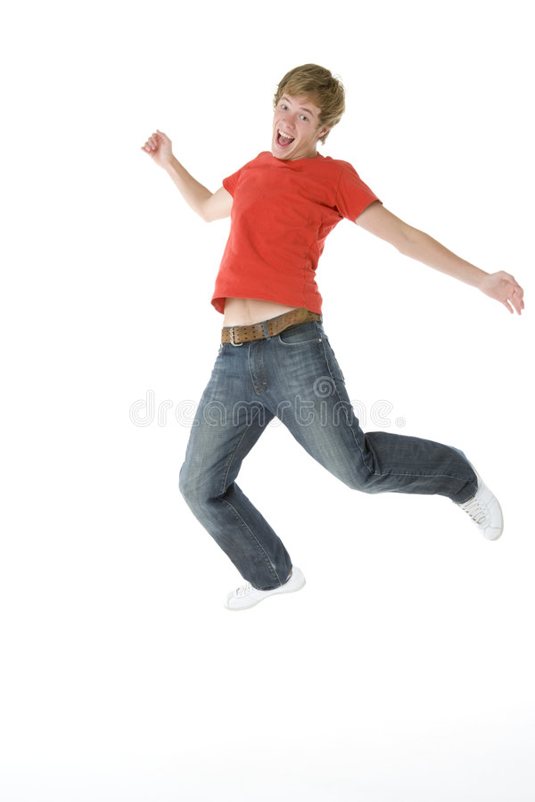 O adolescente que salta no ar imagem de stock