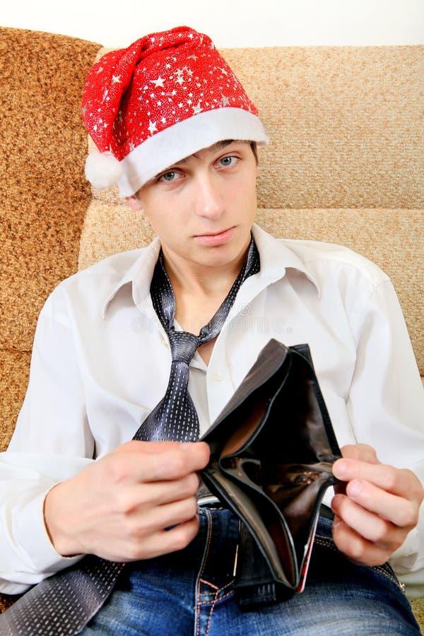 O adolescente verifica a carteira imagens de stock royalty free