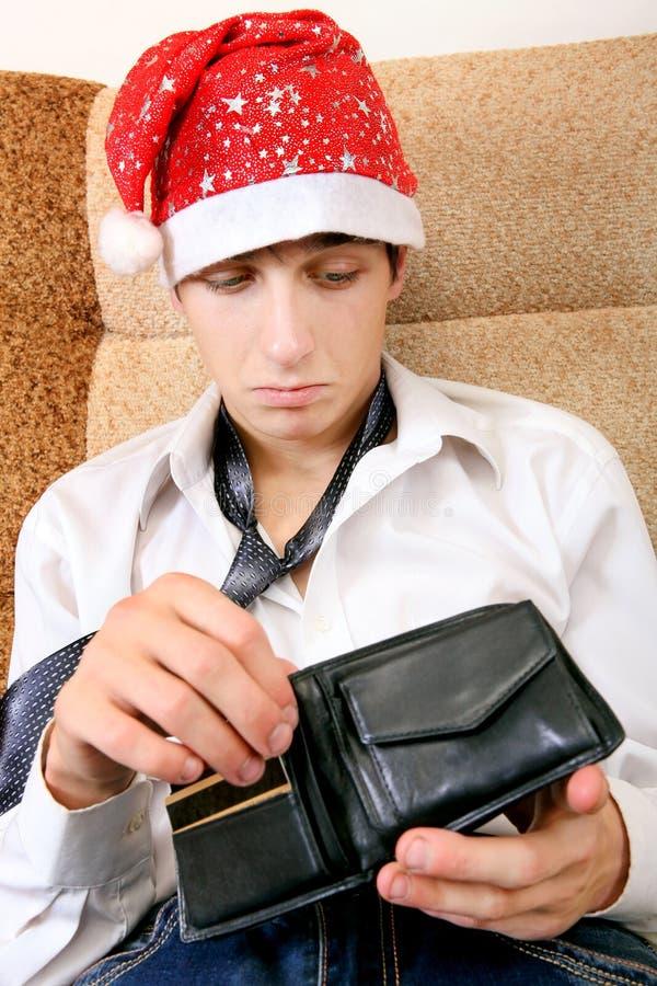 O adolescente verifica a carteira fotografia de stock