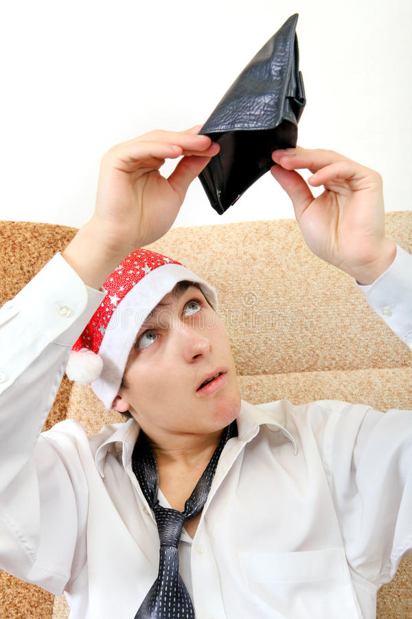 O adolescente verifica a carteira imagens de stock