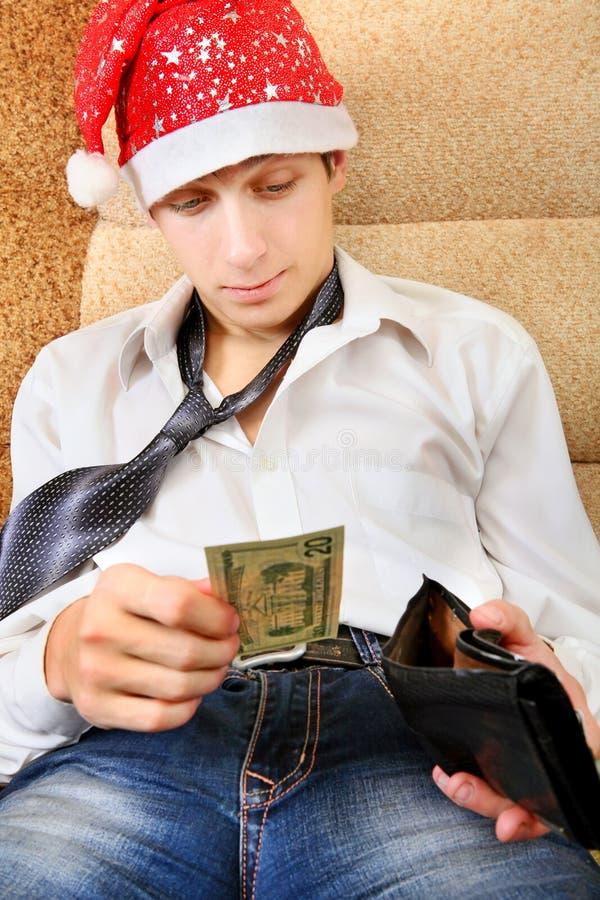 O adolescente verifica a carteira fotografia de stock royalty free