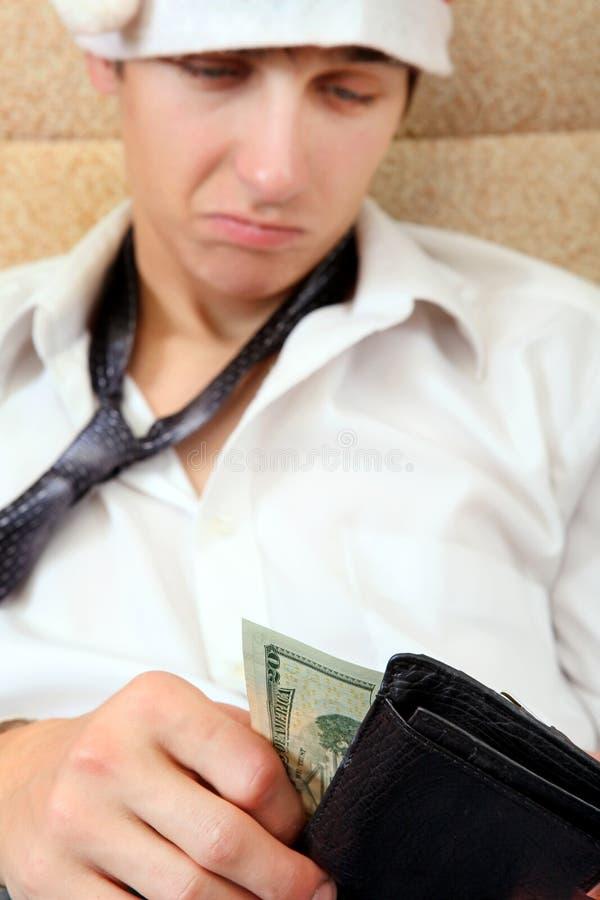 O adolescente verifica a carteira fotos de stock