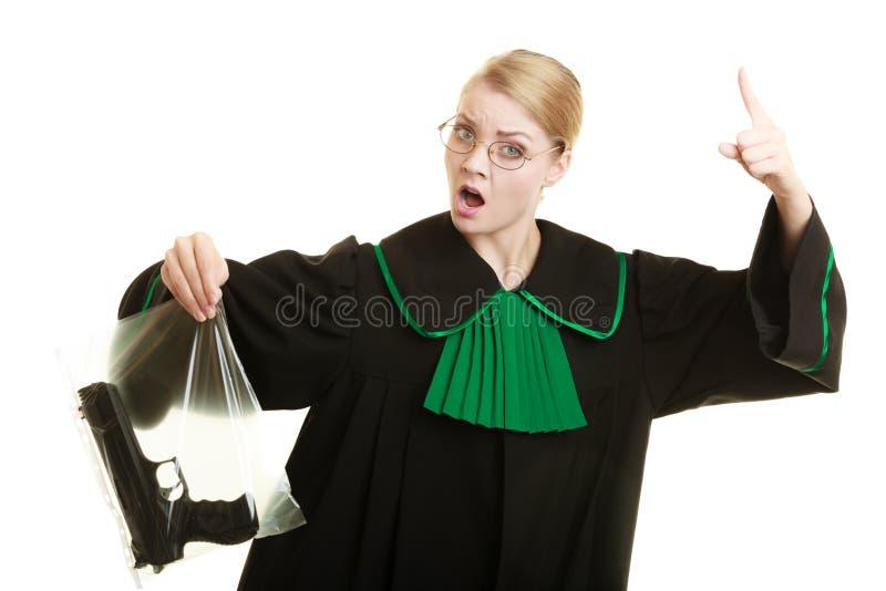O advogado da mulher com saco da arma marcou a evidência para o crime foto de stock royalty free