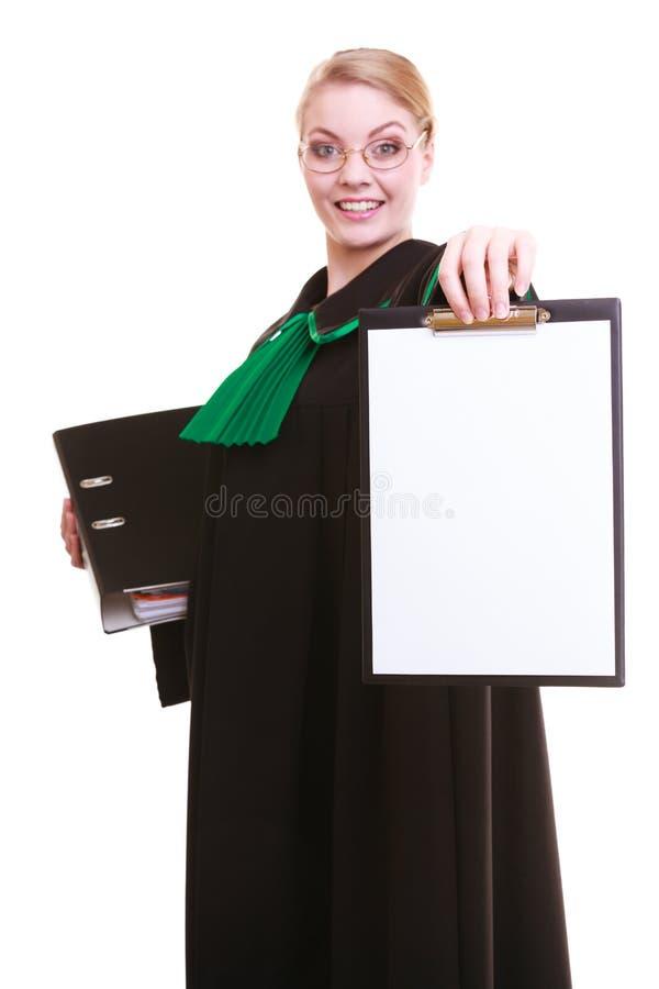 O advogado do advogado da mulher no vestido do polimento do clássico guarda o sinal vazio da prancheta fotografia de stock