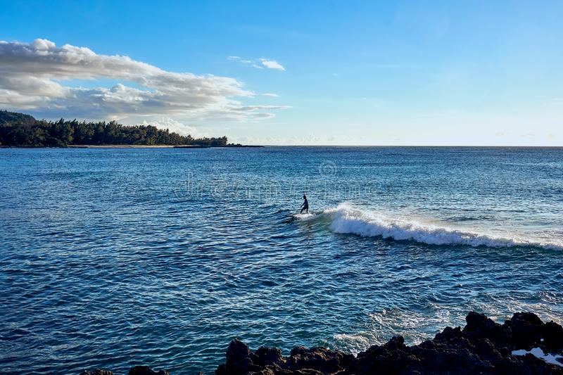 O`ahu, Hawaii, USA - August 4, 2017 : Surfer enjoying the waves at the ocean nearby  a resort stock images