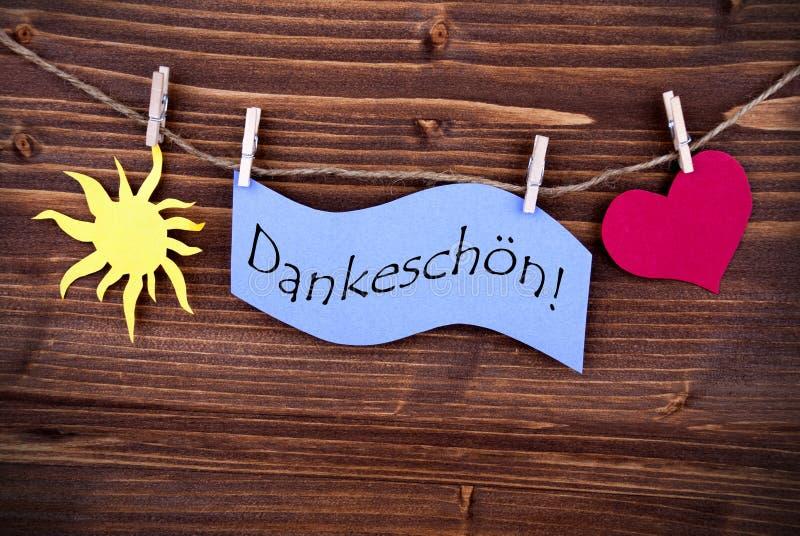 O ½ alemão n do ¿ de Dankeschï da palavra em uma etiqueta roxa fotos de stock royalty free