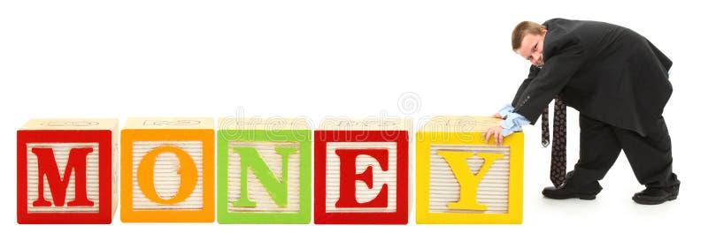 O alfabeto obstrui o DINHEIRO imagem de stock royalty free