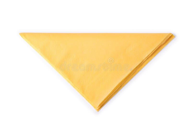 O amarelo dobrou o guardanapo de papel isolado com trajeto de grampeamento imagem de stock