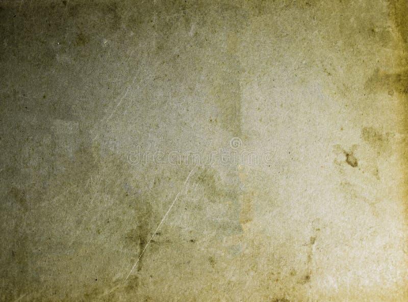 O amarelo manchado velho e o papel marrom texture o molde vazio do fundo fotografia de stock