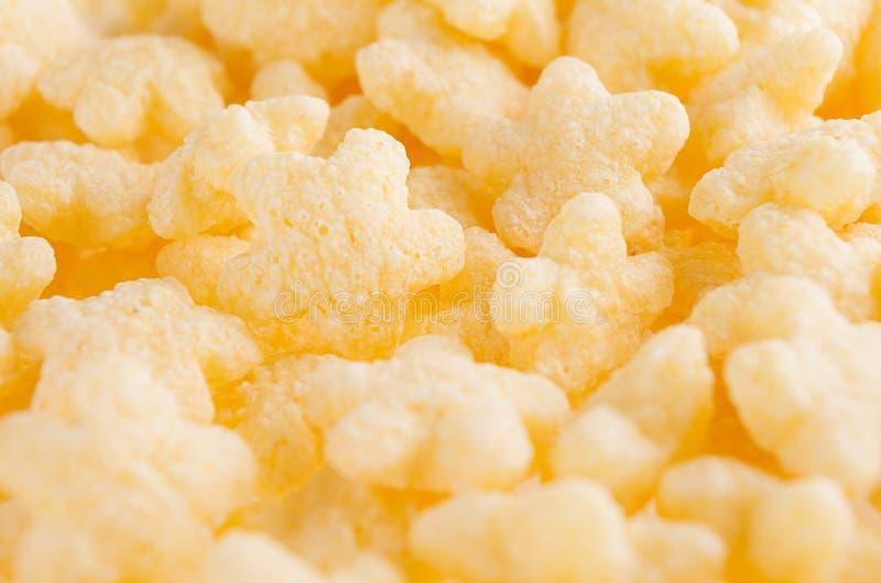 O amarelo stars flocos de milho close up, textura dos cereais fotografia de stock