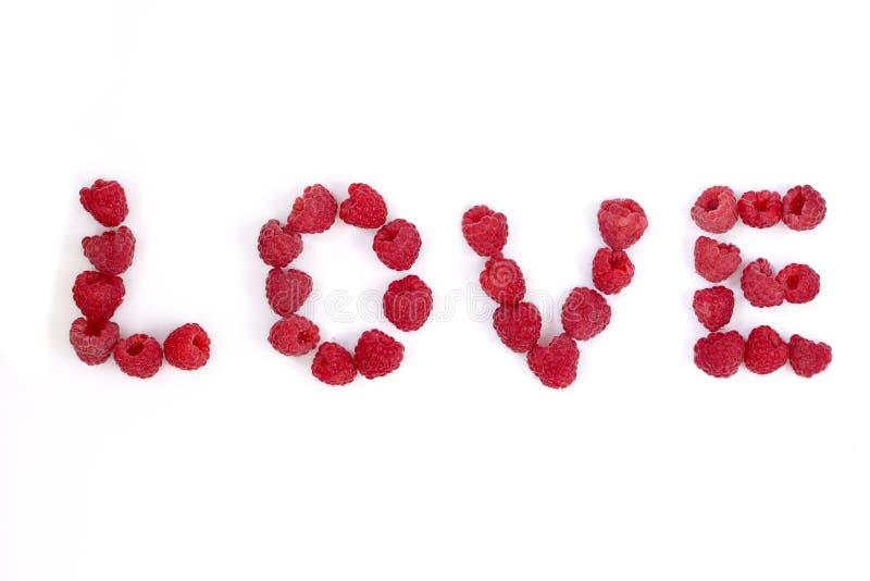 O amor da palavra fez da framboesa letras da baga fotos de stock