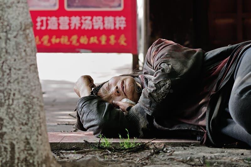 O andarilho de Yaan China-Um está dormindo foto de stock royalty free