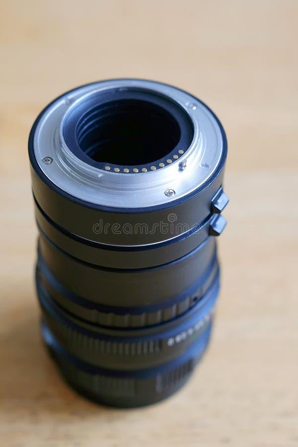 O anel da extensão para a fotografia macro montou na lente fotos de stock royalty free
