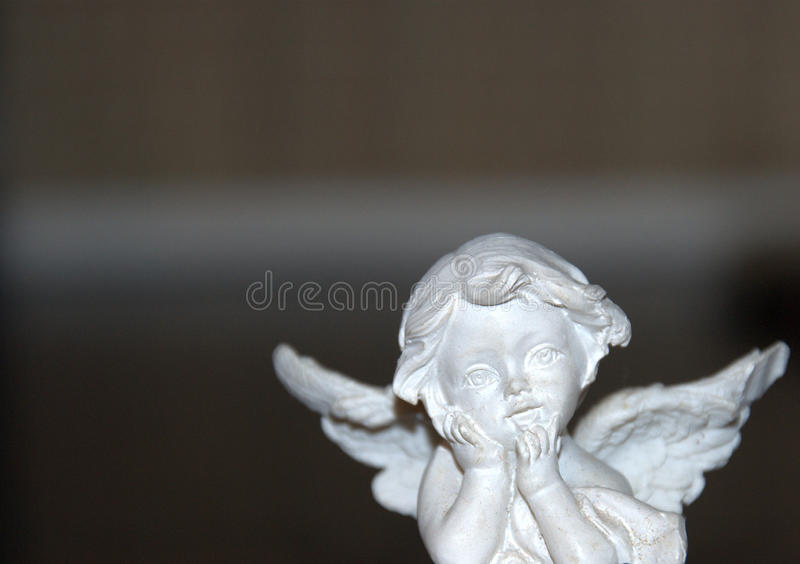 O anjo inclinou seu queixo imagens de stock
