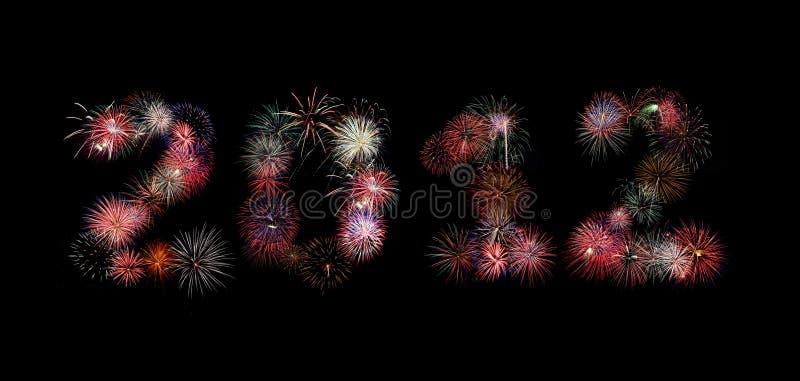 O ano 2012 escrito nos fogos-de-artifício fotografia de stock