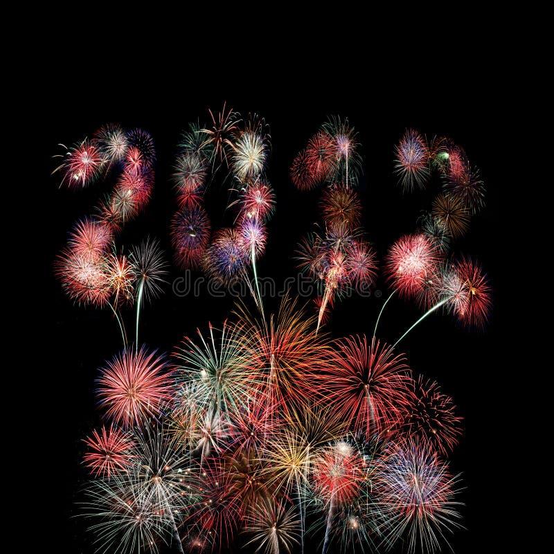 O ano 2012 escrito nos fogos-de-artifício sobre estouros imagem de stock royalty free