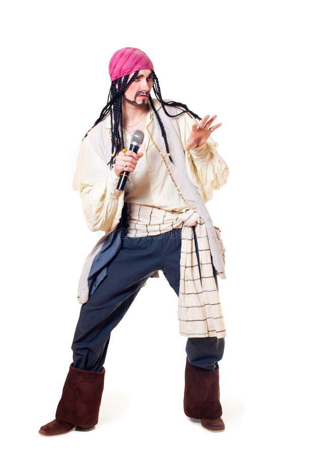 O ator em um terno do pirata foto de stock