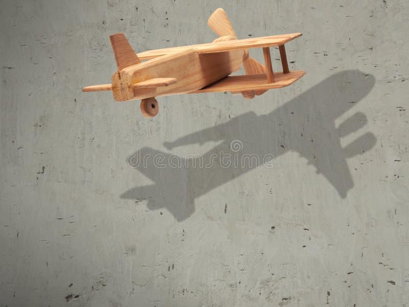 O avião de madeira do voo com o plano da sombra foto de stock royalty free
