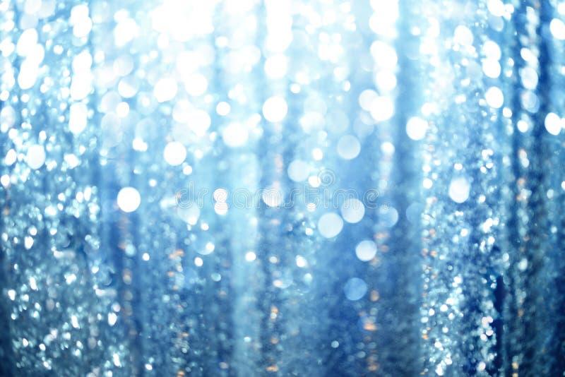 O azul abstrato ilumina o fundo fotografia de stock royalty free