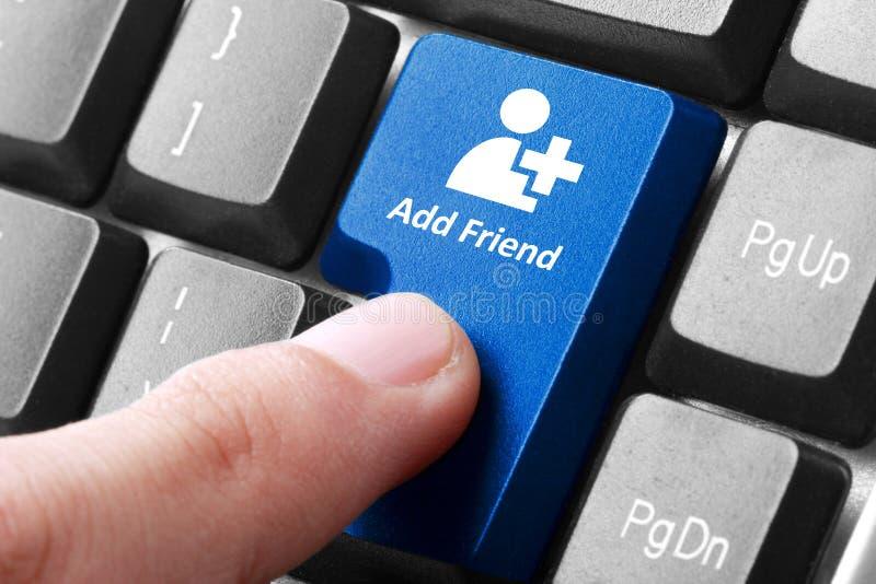 O azul adiciona o botão do amigo no teclado fotografia de stock