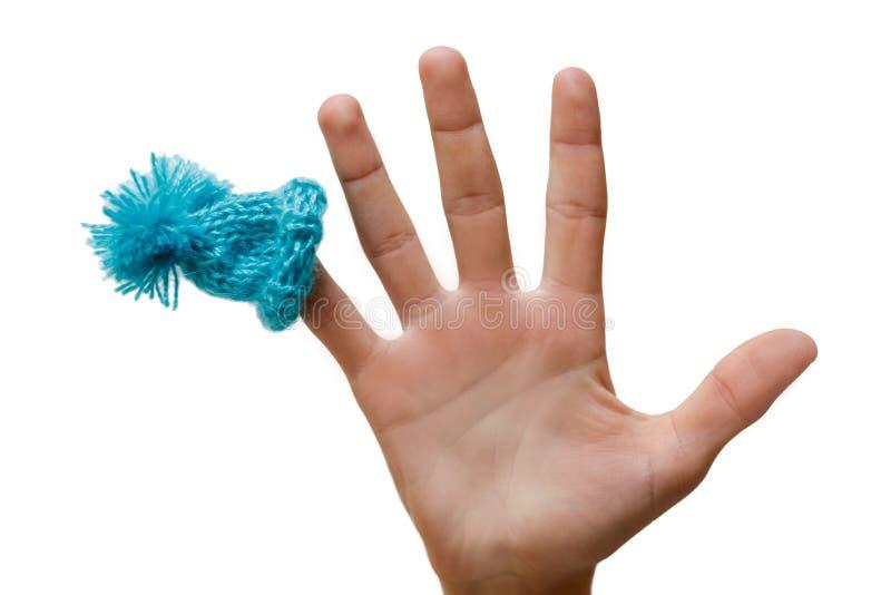 O azul em seu dedo, humor do chapéu do Natal, isolou o objeto tampão o imagem de stock royalty free