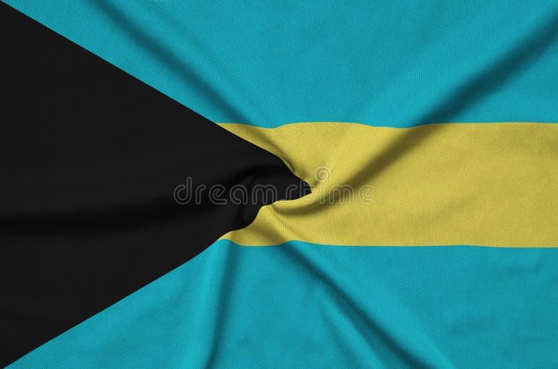 O Bahamas embandeira é descrito em uma tela de pano dos esportes com muitas dobras Bandeira da equipe de esporte foto de stock royalty free