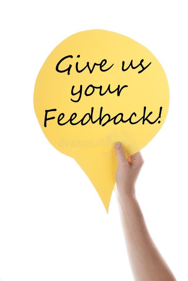 O balão de discurso amarelo com dá-nos o feedback fotos de stock
