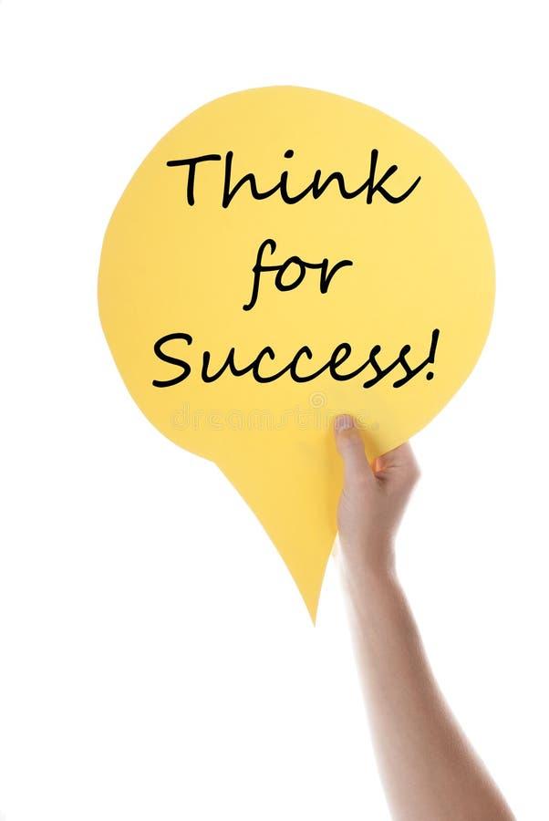 O balão de discurso amarelo com pensa para o sucesso fotografia de stock royalty free