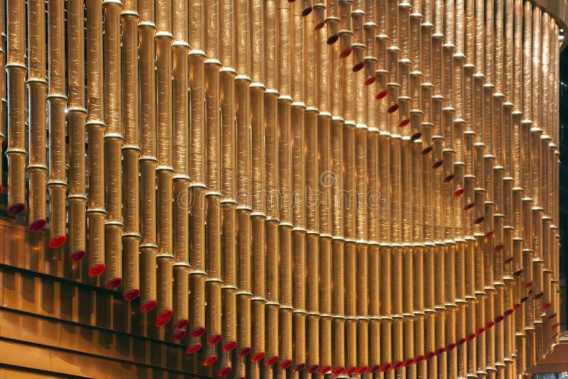 O bambu de bronze das tubulações deu forma imagens de stock royalty free