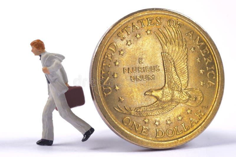 O banqueiro está correndo longe de uma moeda do dólar fotografia de stock royalty free