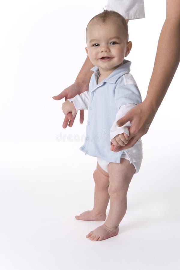 O bebé está estando foto de stock royalty free