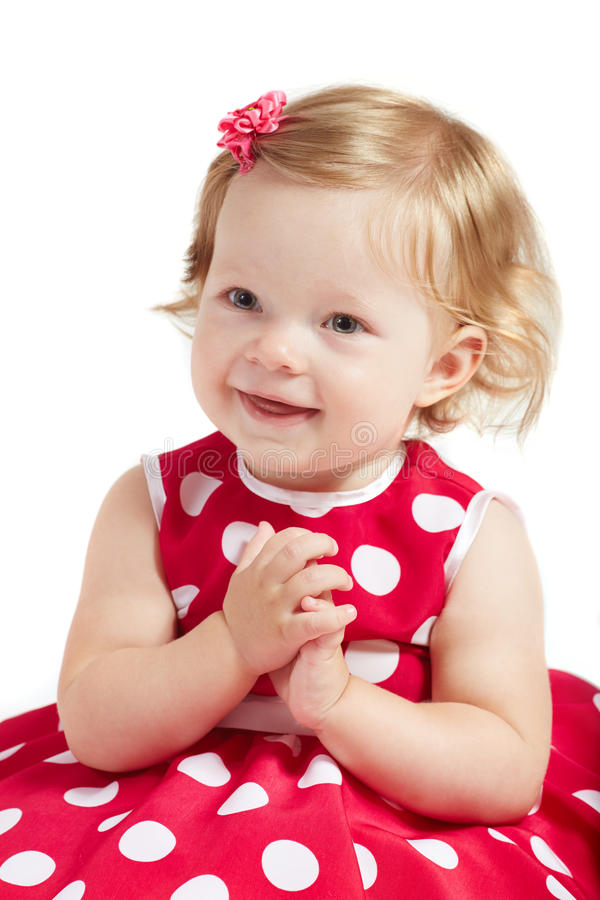O bebê aplaude suas mãos fotografia de stock