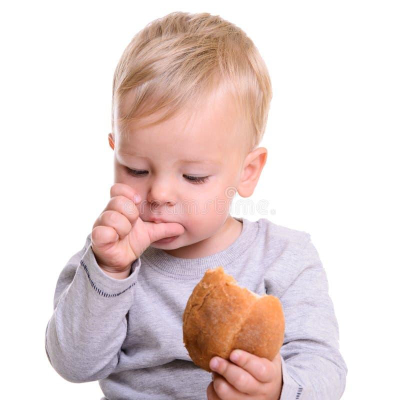O bebê come o pão foto de stock royalty free