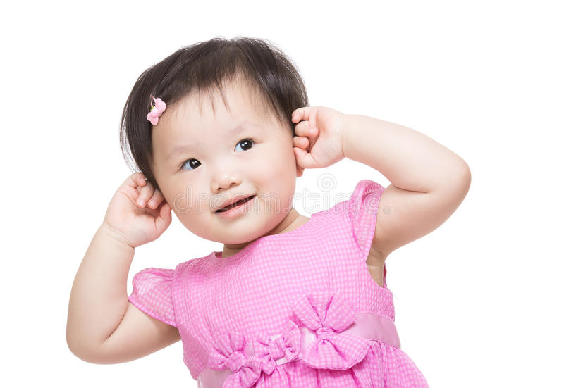 O bebê de Ásia toca em sua cabeça imagens de stock