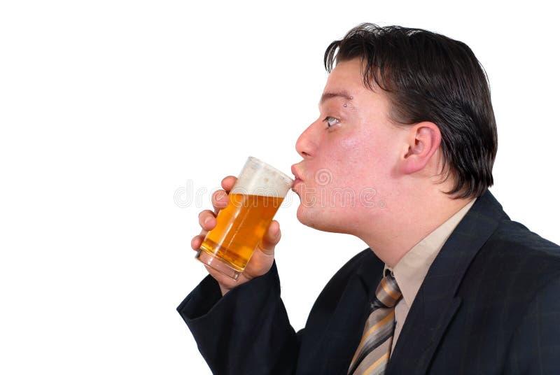 O bebedor de cerveja imagem de stock