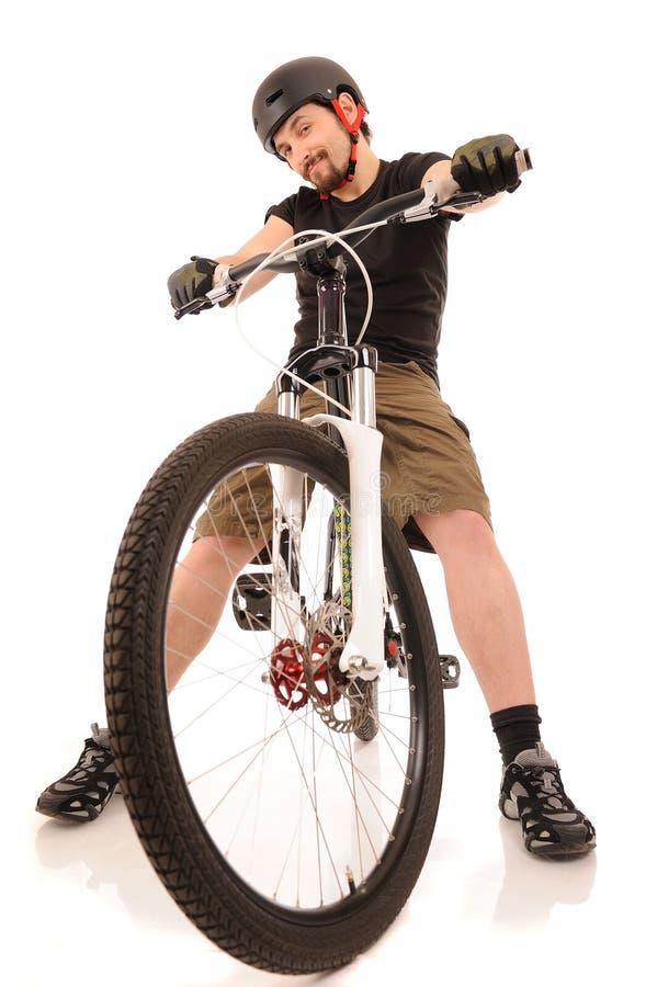 O bicyclist isolado no branco. fotografia de stock