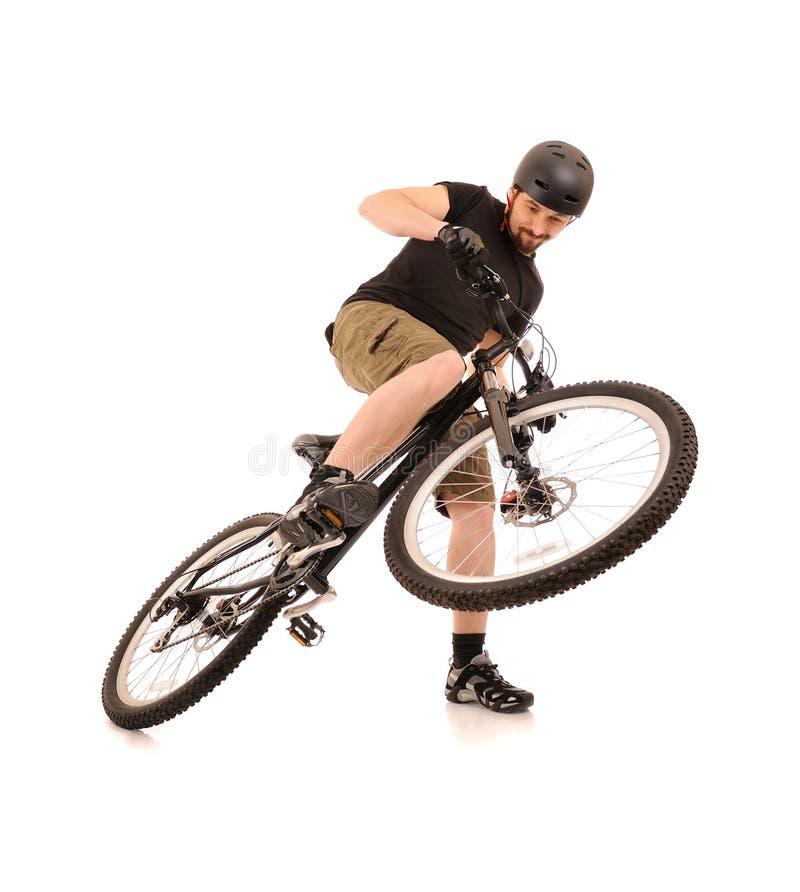 O bicyclist no branco. fotos de stock royalty free