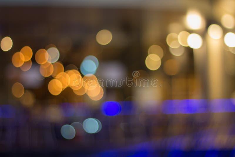 O bokeh claro borrou o fundo, luz - laranja azul fotos de stock royalty free