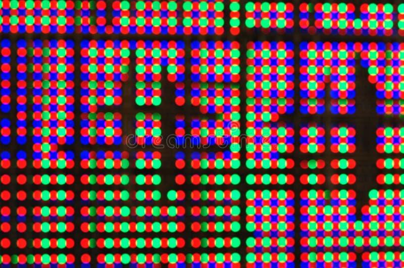 O bokeh colorido na tela do diodo emissor de luz imagens de stock royalty free
