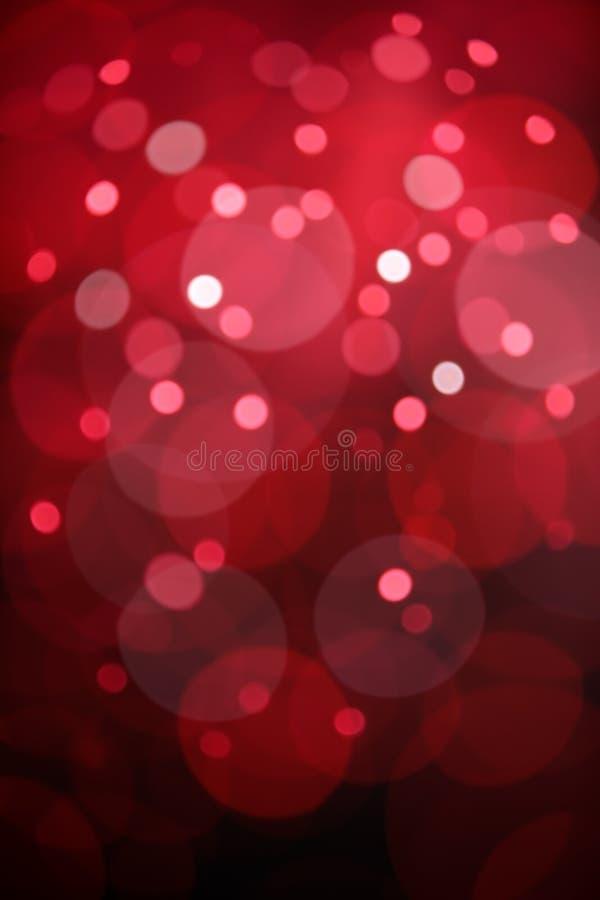 O bokeh vermelho ilumina o fundo fotografia de stock